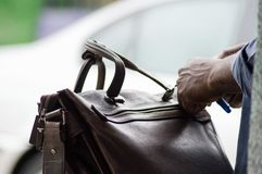 The business bag. This morning this gentleman checks the contents of his bag before going to work Royalty Free Stock Photos