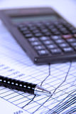 Business balance. Photo of a calculator, Business Chart and pen Royalty Free Stock Images