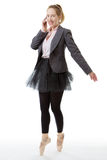 Business ballerina with mobile. Full length studio shot of a business ballerina en pointe with a mobile phone royalty free stock image