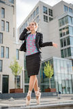 Business ballet dancer on the phone. Ballet dancer dressed in business clothes calling with mobile phone Royalty Free Stock Image
