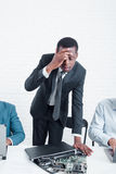Business bankruptcy. Sad manager and broken laptop. Bankruptcy of company. Disappointed and stressed leading manager with broken laptop. Stress, fail, problem at stock image