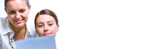 Business banner. Portrait of young pretty women discussing project Stock Image