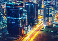 Business bay architecture by night with illuminated buildings, Dubai, United Arab Emirates. Stock Photography