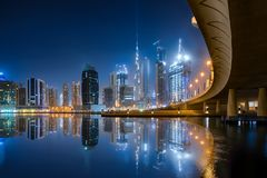 The Business Bay in Dubai during night. With illuminated buildings royalty free stock image