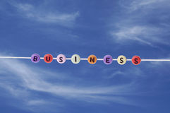 Business beads over blue sky Stock Photography