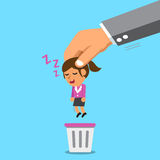 Business big hand throwing a sleeping businesswoman to trash bin Stock Image