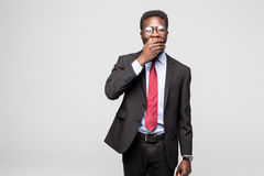 Business black man covering his face on grey background Royalty Free Stock Image