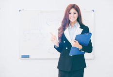 Business black woman holding files. And poining Stock Photo