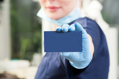 Business blank card closeup in female dentist hand Stock Photo