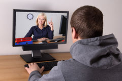 Business blog concept - young man watching video at home Royalty Free Stock Photography