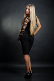Business blonde lady. In black dress Stock Photography