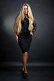 Business blonde lady. In black dress Stock Images