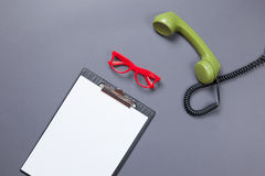 Business board and green handset with glasses Stock Photography