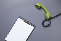 Business board and green handset Royalty Free Stock Photo
