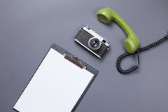 Business board and green handset with retro camera Royalty Free Stock Photos