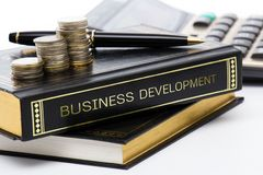 Business book. Book of business development on business desk Stock Photos