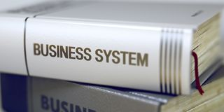 Business - Book Title. Business System. Book in the Pile with the Title on the Spine Business System. Business Concept: Closed Book with Title Business System royalty free stock photography