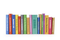 Business books. A row of business hardback tltles, isolated on a white background Stock Photos