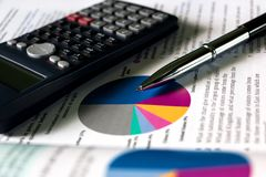 Business, Books, Pen, Calculator and Charts stock images