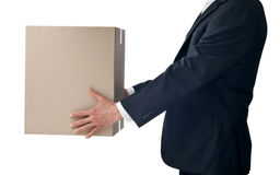 Business Box Moving Delivery. A businessman holding a large carboard moving box on a white background Royalty Free Stock Photography