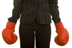 Business Boxing. Person with jacket and red boxing gloves stock photos