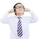 Business boy concentrate - isolated. Business kid concentrating on white background Royalty Free Stock Images