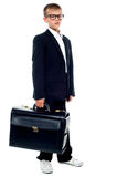 Business boy holding office briefcase Royalty Free Stock Images