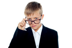 Business boy looking through his eyeglasses Royalty Free Stock Photo