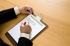 Business brainstorming. A shot of a businessman brainstorming for ideas on a notepad Royalty Free Stock Photos