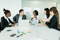 Business brainstorming and exchange of ideas by nicely dressed p Stock Image