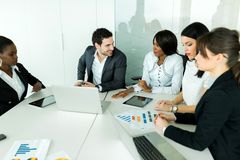Business brainstorming and exchange of ideas by nicely dressed p Royalty Free Stock Photo