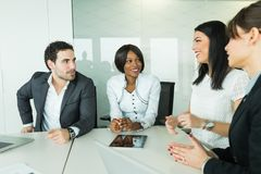 Business brainstorming and exchange of ideas by nicely dressed p Royalty Free Stock Images
