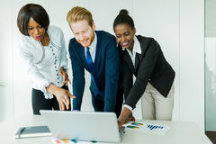 Business brainstorming by happy, nicely dressed multi-ethnic peo Stock Photos