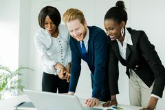 Business brainstorming by happy, nicely dressed multi-ethnic peo Stock Images