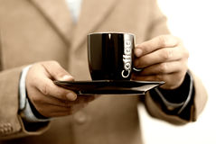 Business break. Business man holding cup of coffee, taking a business break Royalty Free Stock Photo