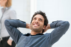 Business break. Happy smiling businessman looking up with dreaming expression at office Stock Photo