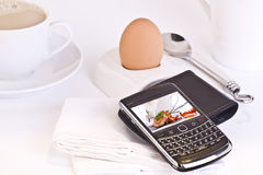 Business Breakfast. With coffee egg and phone royalty free stock images