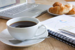 Business breakfast. Meeting with coffee on a table royalty free stock image