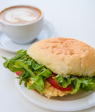 Business breakfast. Coffee and burger royalty free stock photos