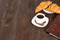 Business breakfast with coffee and croissants decorated with cof Stock Photo