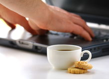 Business Breakfast - cup of coffee and  laptop Royalty Free Stock Photo