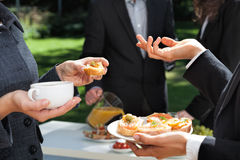 Business breakfast in the garden. People who are eating business breakfast in the garden royalty free stock photo