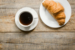 Business breakfast in office with coffee and croissant on wooden table background top view mockup Royalty Free Stock Photography