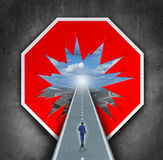 Business Breakthrough. And overcoming road blocks as a red and white stop sign with a hole revealing a path for a person to walk towards career or life success Stock Images