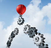 Business Bridge Building. With a red hot air balloon lifting a gear up to the sky to construct and complete a bridged chain of cogs connected together as a Stock Photo