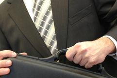 Business briefcase. Businessman holding briefcase, business concept Stock Image