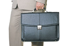 Business briefcase. Holding in hand man in suit Stock Image
