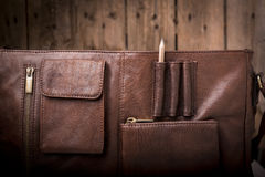 Business Briefcase Bag. A man's business briefcase bag, leather satchel with a pencil royalty free stock images