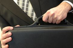 Business briefcase in hands. Businessman holding briefcase, business concept Royalty Free Stock Photography