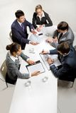 Business briefing. Team of five business people discussing an important question at briefing Stock Photography